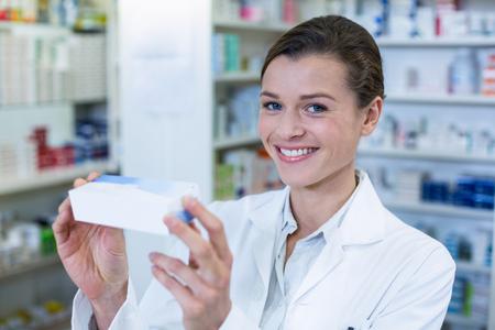medicine box: Portrait of pharmacist checking a medicine box in pharmacy