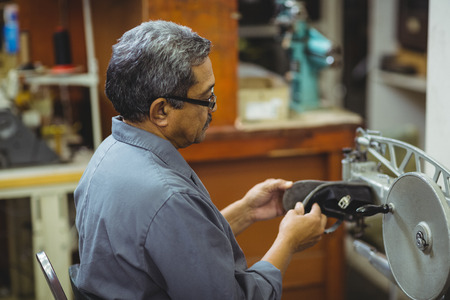 outsole: Shoemaker using sewing machine in workshop