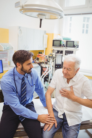 surgical light: Male doctor examining a patient at the hospital Stock Photo