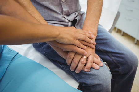 consoling: Close-up of female doctor consoling a patient at the hospital Stock Photo