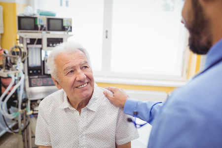 interacting: Doctor interacting with patient at the hospital Stock Photo