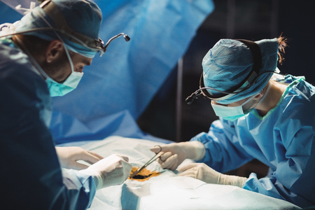 operation room: Surgeons performing operation in operation room at the hospital Stock Photo