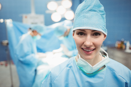 scrub cap: Portrait of female surgeon in operation room at the hospital