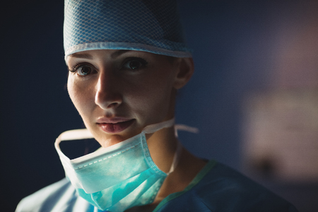 operation room: Portrait of smiling female surgeon in operation room at the hospital Stock Photo
