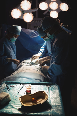 Surgery team operating a patient in an operating room at the hospital