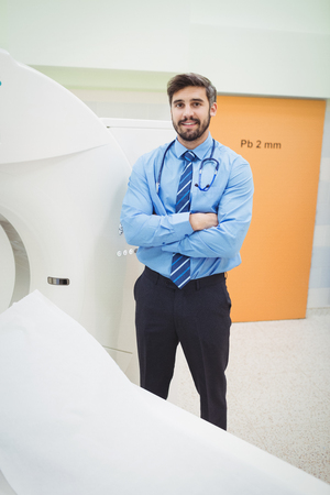 radiation therapy: Portrait of doctor standing near mri scanner at the hospital Stock Photo