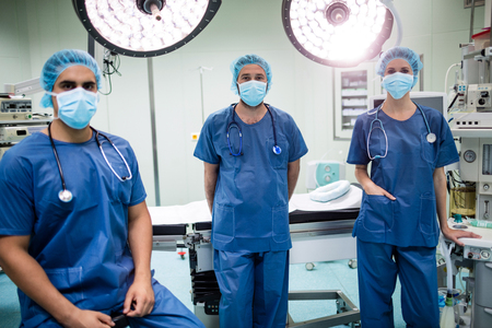 surgical light: Portrait of surgeons in operation room at hospital Stock Photo