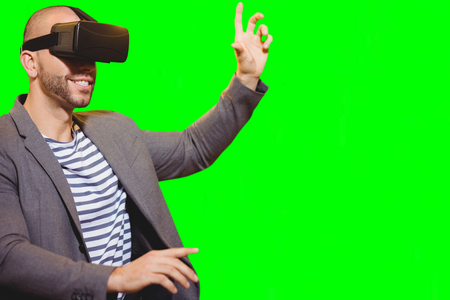 virtual reality simulator: Man with virtual reality simulator against green vignette