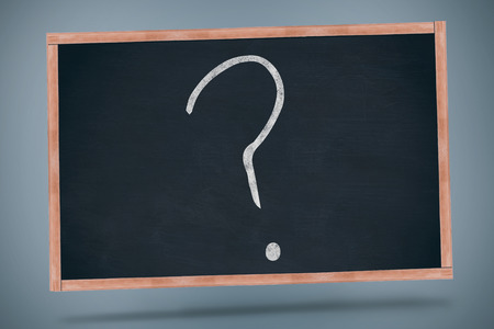 interrogative: Black question mark drawing against black chalkboard Foto de archivo