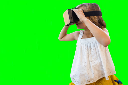 virtual reality simulator: Girl wearing virtual reality simulator against green vignette