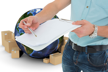 boiler suit: Delivery man with clipboard asking for signature against globe and cardboard boxes