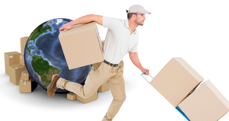 Delivery man with trolley of boxes running against globe surrounded by cardboard boxes