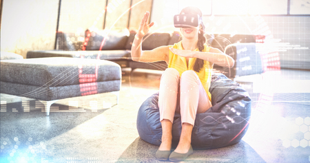 virtual reality simulator: Composite image of face against  woman  wearing virtual reality simulator  Woman  wearing virtual reality simulator while gesturing at home