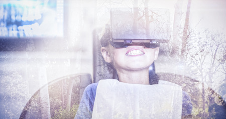 virtual reality simulator: Trees growing in forest against cheerful boy with virtual reality simulator