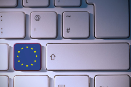 backlit keyboard: european union flag against white background with vignette Stock Photo