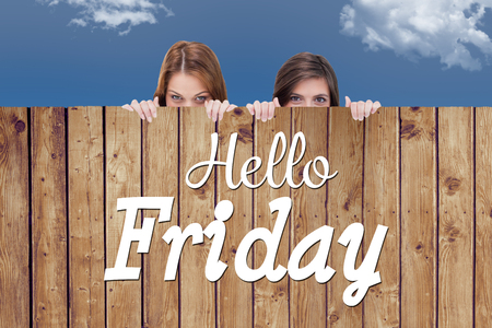 Hello Friday word against wooden planks Stock Photo