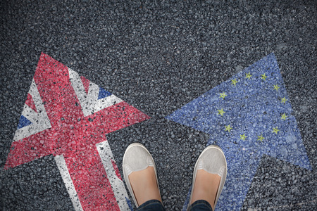 casually dressed: Casually dressed womans feet against close-up of european flag