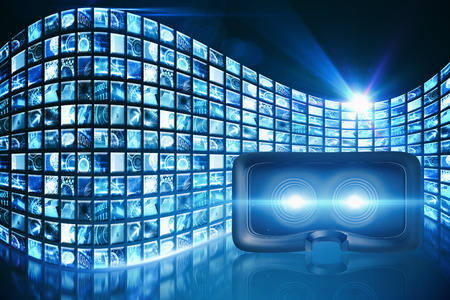 Close-up of black virtual reality simulat against curve of digital screens in blue Stock Photo