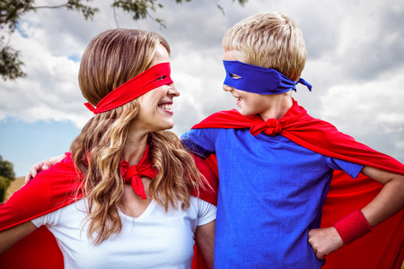 national women of color day: Landscape of countryside against happy family wearing a disguise Stock Photo