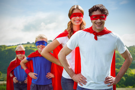 national women of color day: Country scene against happy family pretending to be superhero Stock Photo