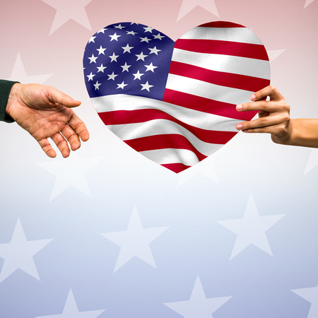 digitally generated image: Digitally generated image of person holding heart shape American flag