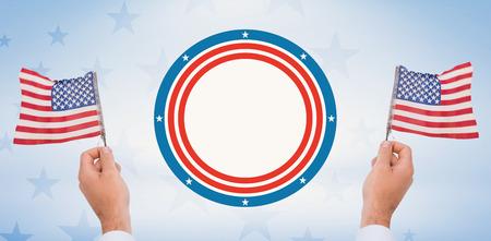 digitally generated image: Digitally generated image of human hand waving American flag