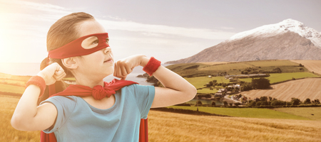 country girl: Cute girl in eye mask and cape against country scene with mountain Stock Photo