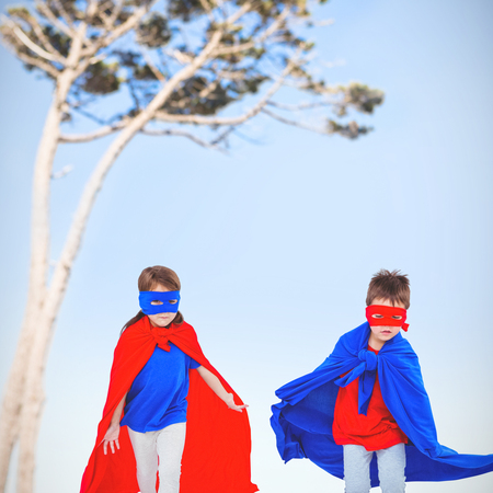 computer animation: Masked kids running pretending to be superheroes against view of a tree