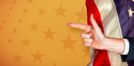 digitally generated image: Digitally generated image of human hand pointing against American flag