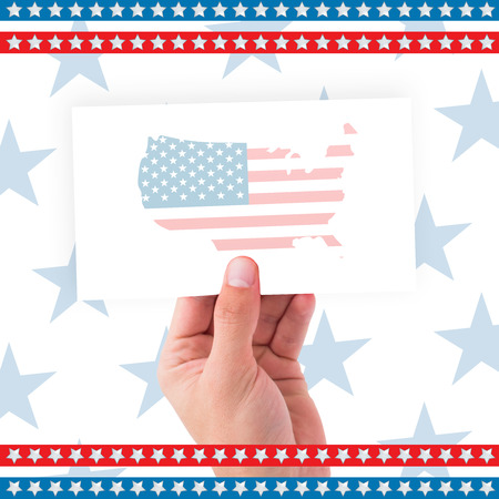 digitally generated image: Digitally generated image of hand holding placard against american flag