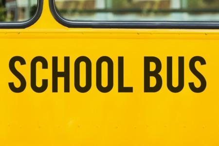 telephone poles: Close up of school bus