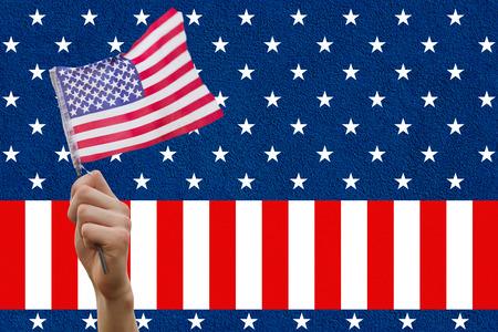digital composite: Digital composite of hand holding flag against American flag Stock Photo