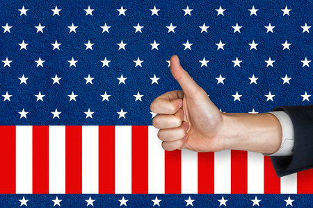 digital composite: Digital composite of thumbs up against American flag