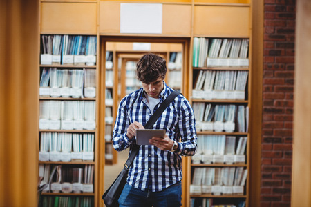 higher intelligence: Student using digital tablet in library at college