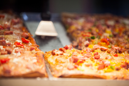 Close-up of pizza in display at supermarket