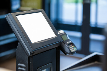 billing: Billing machine and credit card terminal at cash counter in supermarket