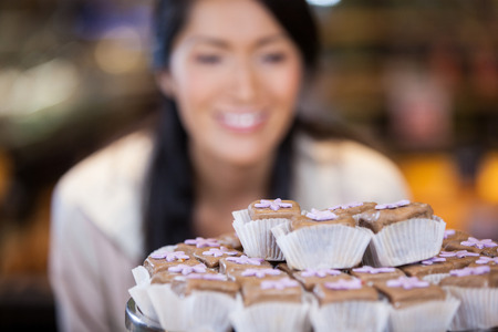Close-up of cupcakes on cake stand in supermarket