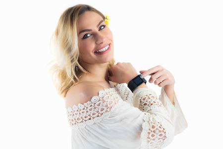 off shoulder: Portrait of beautiful woman posing with smartwatch against white background Stock Photo