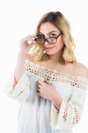 Close-up of beautiful woman posing with spectacles against white background