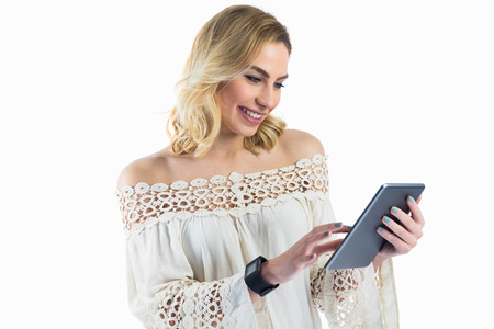 off shoulder: Beautiful woman using digital tablet against white background
