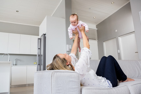 babyboy: Mother playing with her baby at home