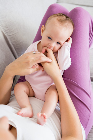 Mother playing with her baby in bedroom at home Stock Photo
