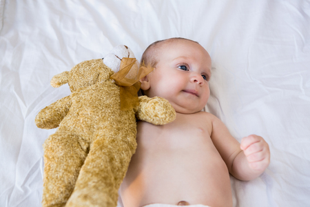 babyboy: Baby lying on baby bed at home