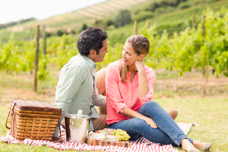 each other: Happy couple interacting with each other at vineyard