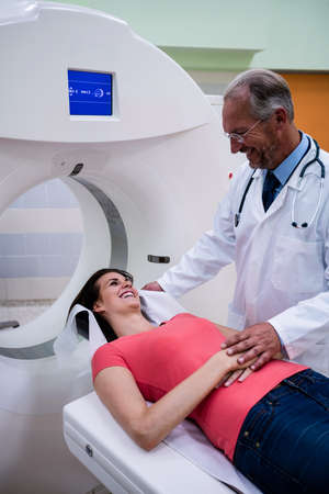 mri scan: Doctor consoling a patient before an mri scan at hospital