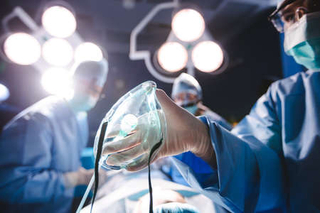 oxygen mask: Surgeon holding oxygen mask in operation room at hospital