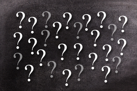 questionmarks: Digital composite of Question-marks on chalkboard Stock Photo