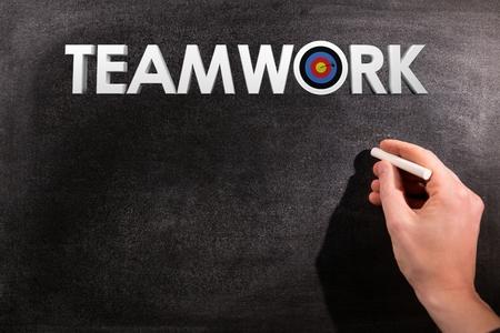 hand writing: hand writing teamwork on crayon bord Stock Photo