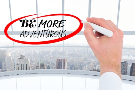 adventurous: composite of hand drawing be more adventurous graphic with city background Stock Photo