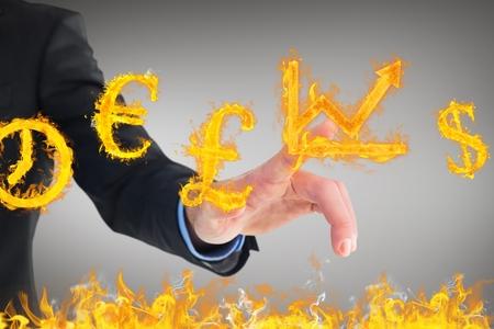 burning money: businessman pointing at burning graph money and clock symbols